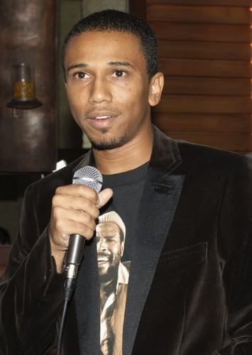 Aaron McGruder as Writer in The Addams Family