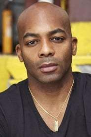 Brandon Victor Dixon as Tom Collins in Rent