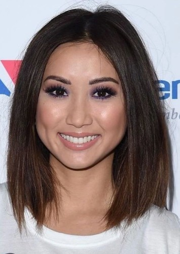 Brenda Song as Employee #2 in Typical Work Com Movie/Television Series