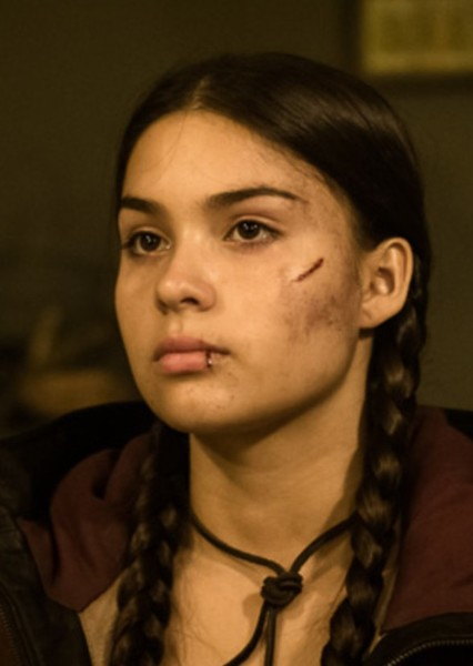 Devery Jacobs as Katniss Everdeen in The Hunger Games