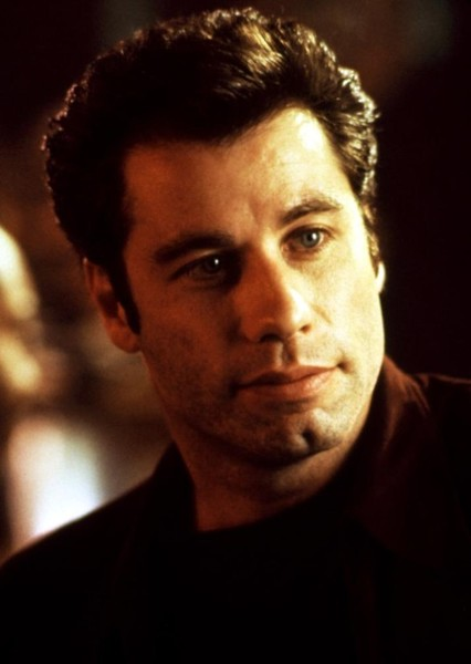 John Travolta as Nick Dunne in Gone Girl (1994)