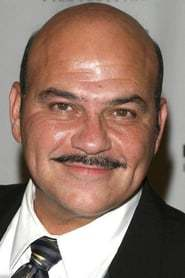 Jon Polito as Arnold Flass in Batman: O Cavaleiro de Gotham