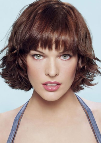 Milla Jovovich as Pamela Isley in Batman: O Cavaleiro de Gotham