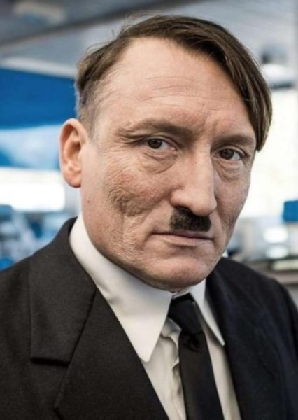 Oliver Masucci as Adolf Hitler in World War II: The War in the Europe