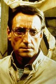 Roy Scheider as Hollis Mason in Watchmen (1989) Casting