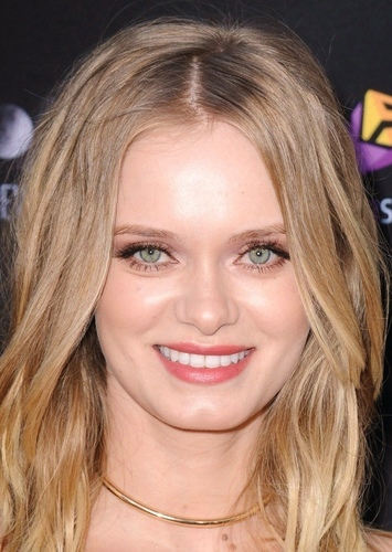 Sara Paxton as Clerk #1 in Typical Work Com Movie/Television Series