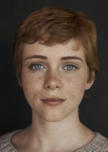 Sophia Lillis as Marty in Grease