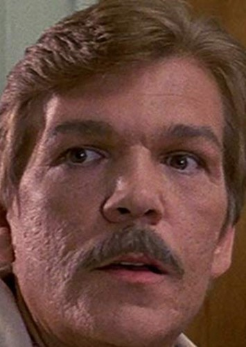 Tom Atkins as Commissioner James Gordon in Batman (1985)